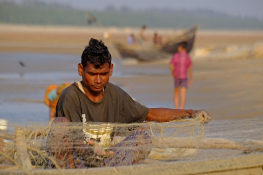 Fisherman mending and sorting nets